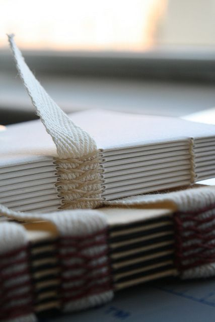 Handmade book text block sewn on linen tapes with French link stitch
