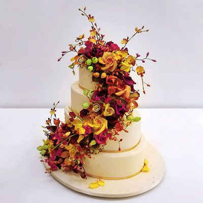 Ron Ben-Israel Cakes  Vibrant blooms liven up simple yellow, oval-shaped confection.