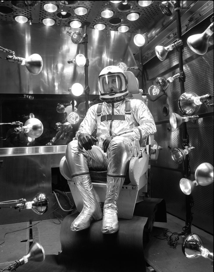 Scott Crossfield sits in a thermal-vacuum chamber during tests of a prototype XMC-2 pressure suit | Photo Credit: Boeing