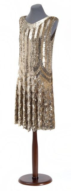 Sleeveless scoop neck chemise completely covered in bright silver and gold sequins in a stripe and swag design. Made in Paris in the late 1920s