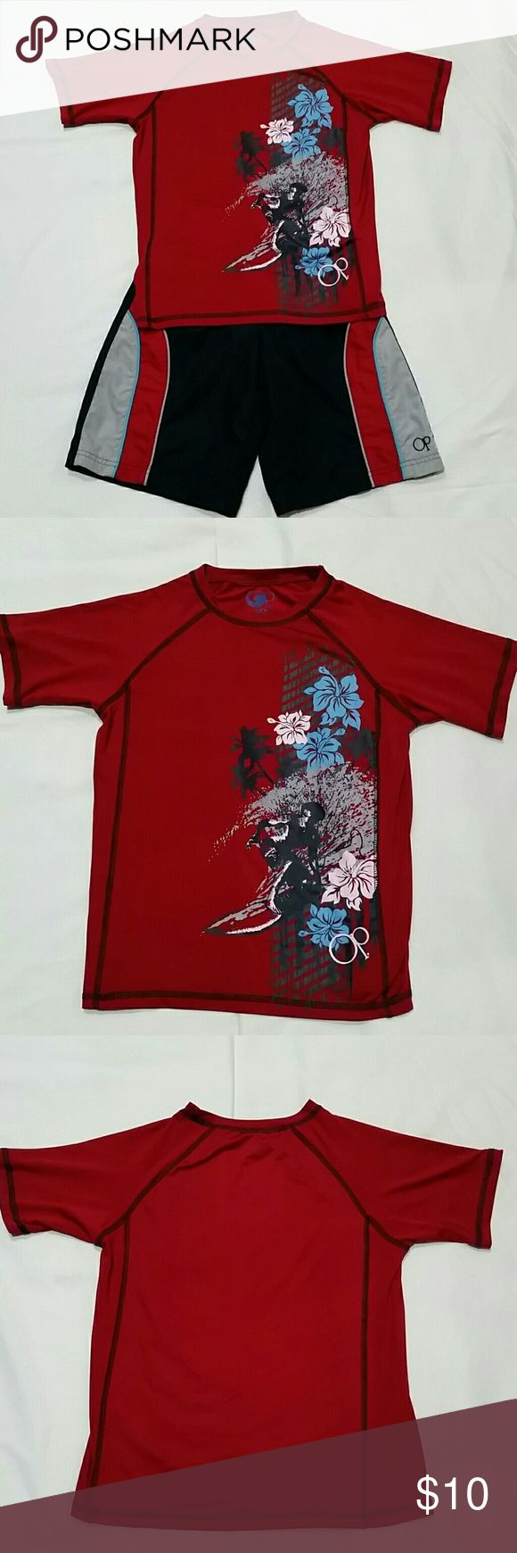 Boys 6/7 Swimsuit Set This surf themed swim suit set by Ocean Pacific is a size Small (6-7). It is in great condition.  Both pieces feature the colors black, grey, blue, and red. The red rash guard features a surfer on the waves surrounded by blue and white hibiscus flowers and black palm trees. The black trunks feature red, blue, and gray stripes and a small OP logo at the bottom. They have an elastic waistband and outer drawstring.  Please see my photos for close-up detail of both pieces…