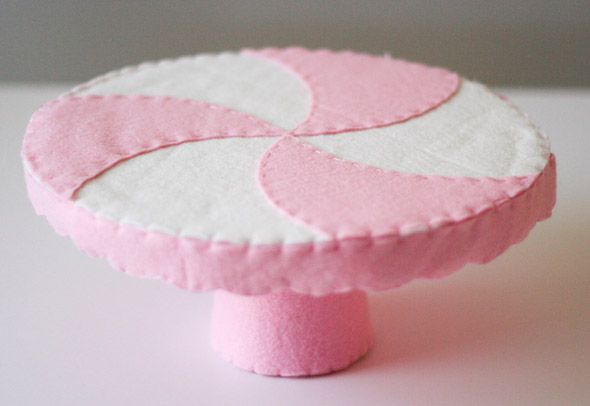 It's a felt cake stand! She sells the pattern, but I just want to look at it.