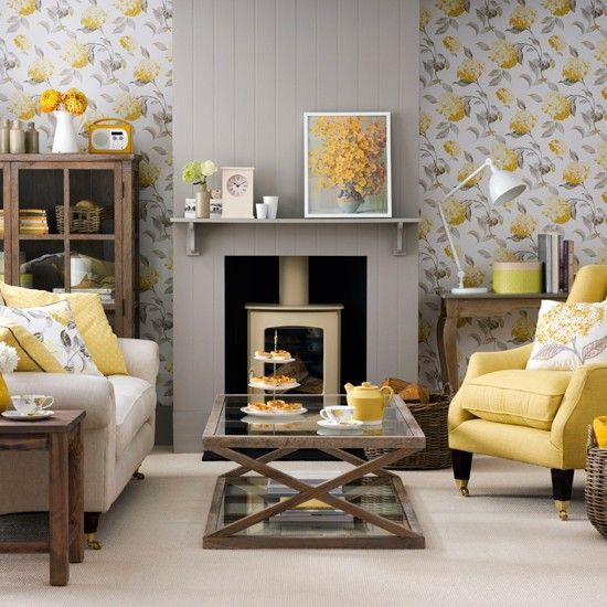 Grey living room with yellow accents | The perfect balance of warm gold and cool lead grey creates a hamonious and relaxed feel that's perfect for a living room. Beige flooring and upholstery keep the room looking airy.