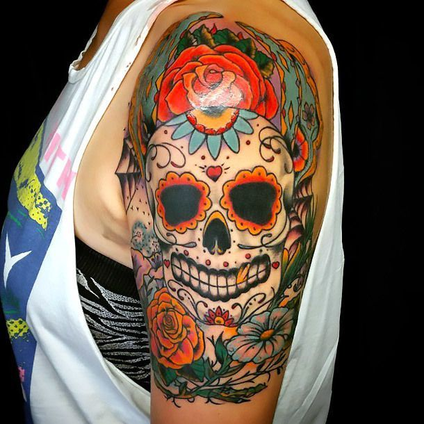 A Beautiful Day Of The Dead Tattoo Idea For Girls And Women Colorful And Vivid Piece Color Col Sugar Skull Tattoos Skull Tattoo Design Shoulder Piece Tattoo