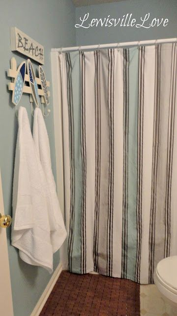 Found shower curtain at T.J. Maxx - the colors & stripes set the mood - canvas fabric pulls room together at $15!