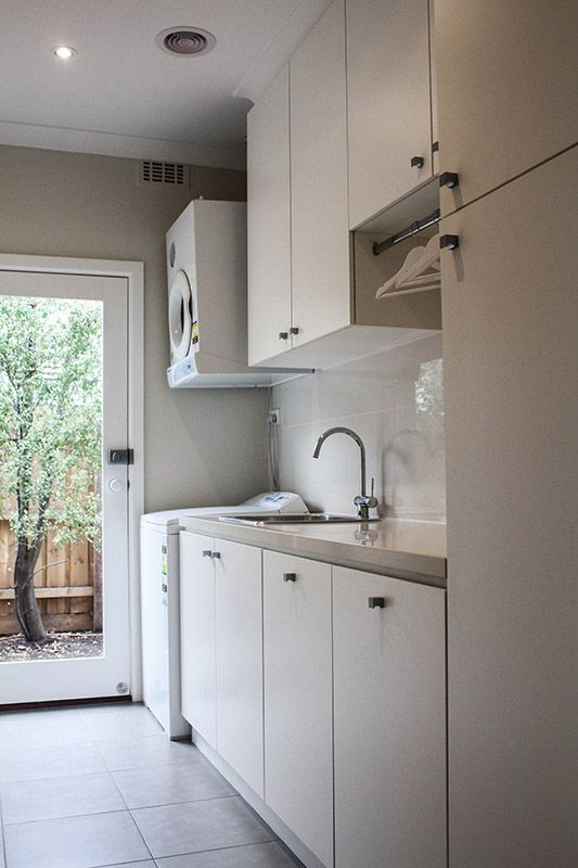 eat.bathe.live :: Hampton residence by eat.bathe.live - laundry with integrated hanging space