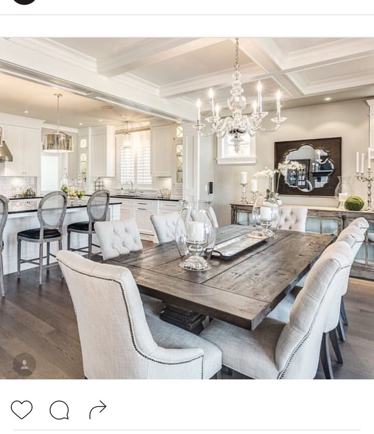 Although technically a breakfast table because it is in the kitchen, the decor makes this look like a formal dining table.