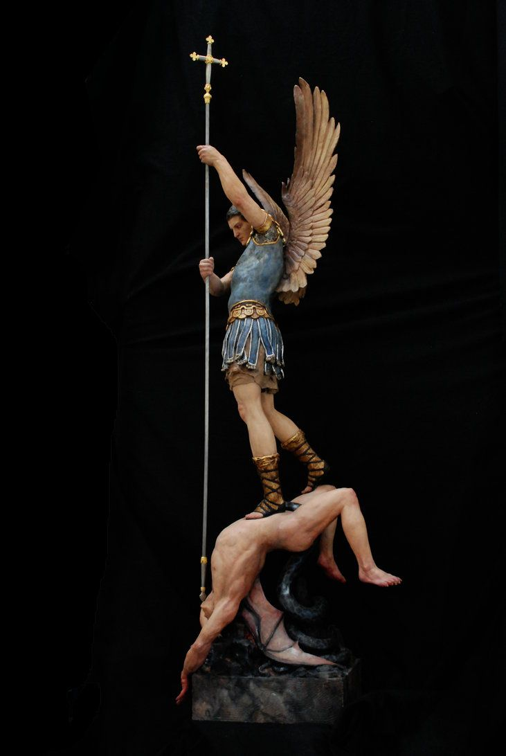 """I created this original sculpture of St. Michael the Archangel in clay. The figures were cast in solid resin. The statue was then meticulously hand painted. This statue is approximately 45.5"""" tall...."""