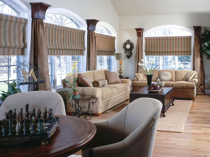 Living Room Window Treatment Ideas With Brown Striped Roman Shade And Brown  Curtain Combined Cream Sofa And Brown Wooden Rectangle Table.