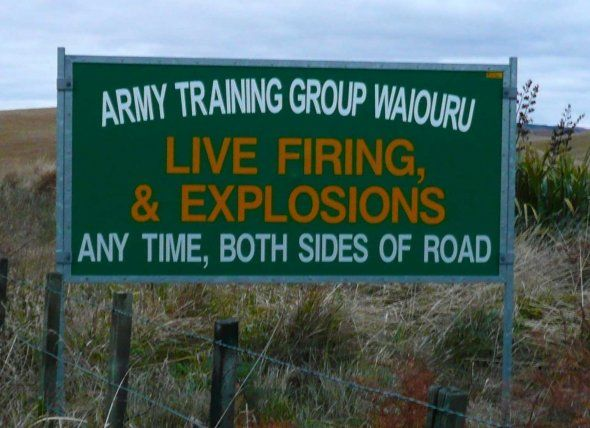 My favorite funny road sign.  Found in the center of the North Island of New Zealand.  Where should one drive if there is live firing on both sides of the road?  Photo by Rhonda Albom 2009