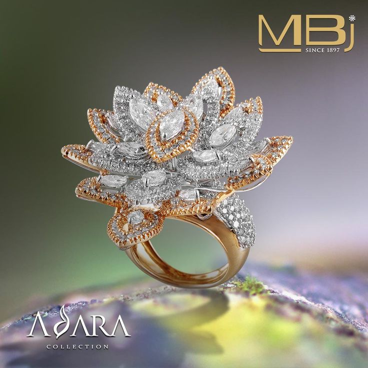 Boat shaped cocktail diamond ring with round & pear shaped diamonds from ADARA collection.