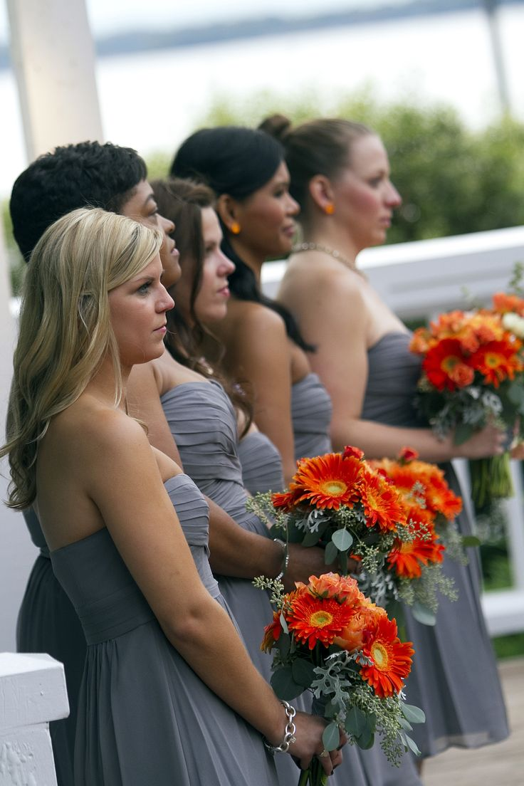 All about gray and orange- beautiful fall wedding- the bridesmaid's bouquets were simple in orange gerbera daisies and silver accents of dusty miller and seeded eucalyptus...