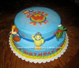 Homemade Wonder Pets Birthday Cake: I created two layers, one 10 and one 12 (different flavors)for this Wonder Pets Birthday Cake. The cake was covered with blue buttercream frosting. I piped