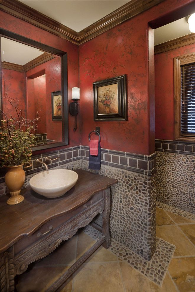 This powder bath really stands out with the great use of stone, tile and faux paint.