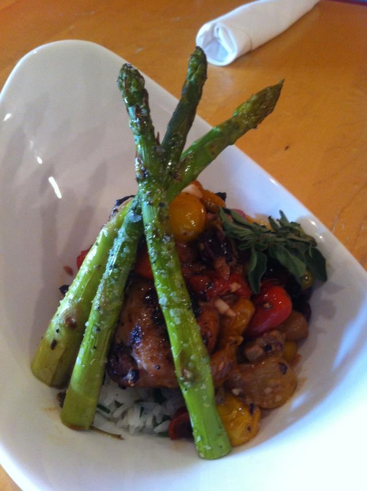 Chargrilled tombo (white tuna) cooked medium rare, served with scallion rice and heirloom tomato and olive buerre blanc and grilled asparagus. $25  http://www.facebook.com/BrosBrasserie