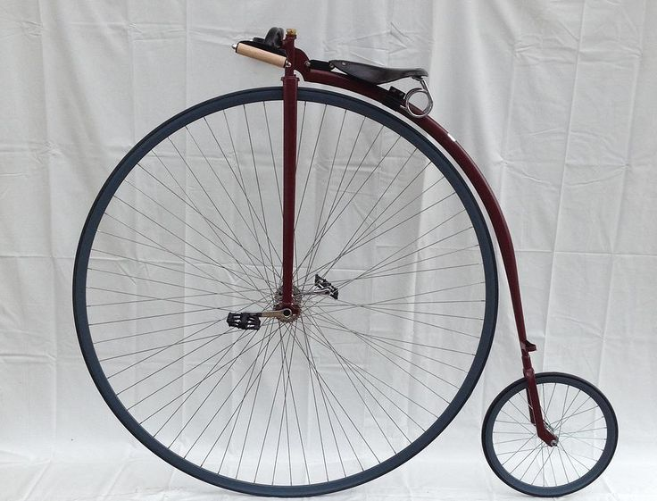 Custom built Penny Farthing by Dan Bolwell, Crome hubs, hunter red frame and blue rims.  wee.pennyfarthingdan.com.au