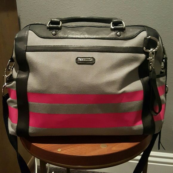 Rebecca Minkoff Diaper Bag Grey and pink Rebecca Minkoff Diaper Bag Canvas material with Leather trim Has metal feet on the bottom of the bag. 1 zip pocket inside and 7 regular pockets  Shoulder strap and also a crossbody strap  I used this as an overnight bag but only used it on two occasions.  It's in great condition. Rebecca Minkoff Bags Baby Bags