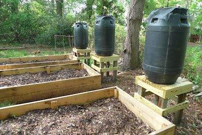 How to Make a Rain Barrel used to water raised bed garden. Very cool!