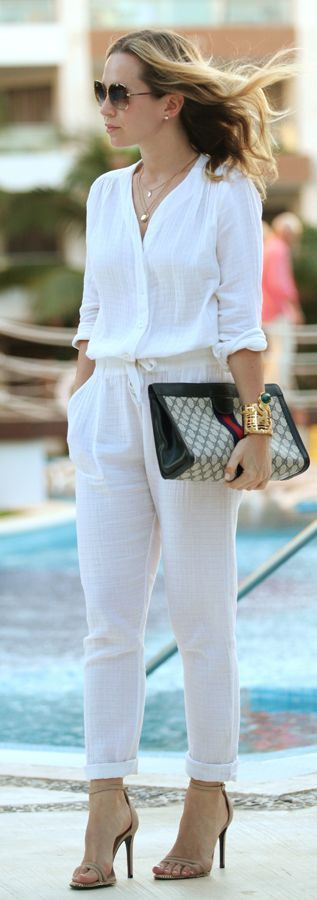 White skinnies, oversize handbag, striped shirt and pink pumps.