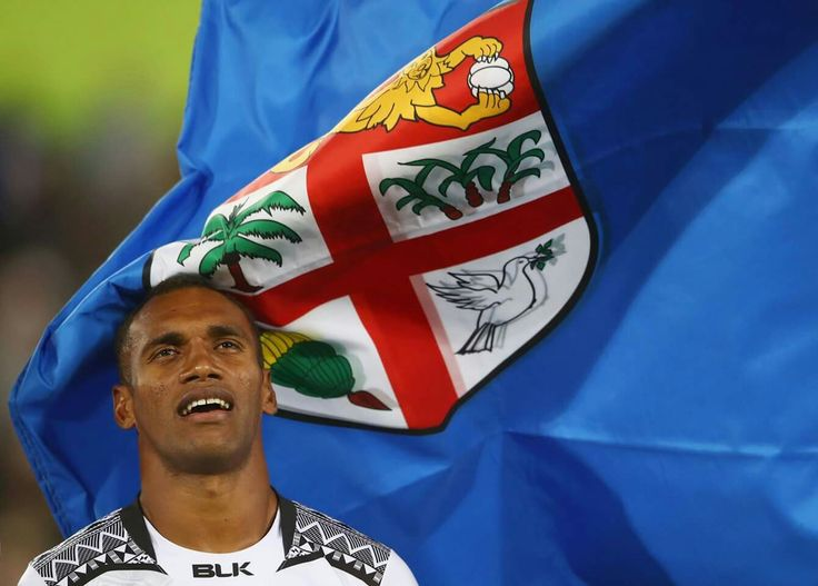 RIO DE JANEIRO, BRAZIL - AUGUST 11: The Fiji national flag flutters next to captain Jerry Tuwai of Fiji prior to the Men's Rugby Sevens Gold medal final match between Fiji and Great Britain on Day 6 of the Rio 2016 Olympics at Deodoro Stadium on August 11, 2016 in Rio de Janeiro, Brazil. (Photo by Mark Kolbe/Getty Images)