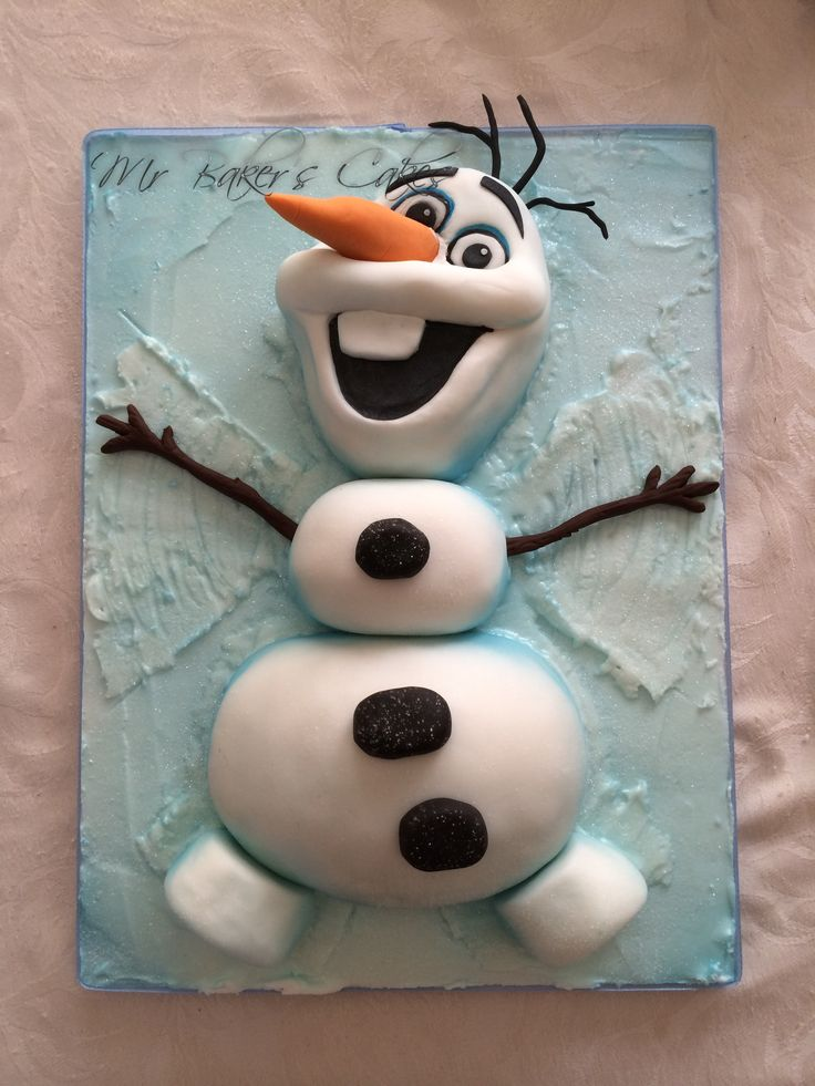 Frozen Olaf Snow Angel Cake - Vanilla sponge and vanilla buttercream, carved and covered in fondant. Arms, hair and carrot all fondant with gum trag and eyes are hand painted. Sat on a base of fondant, covered with royal icing, then whole thing airbrushed to give blue effect...