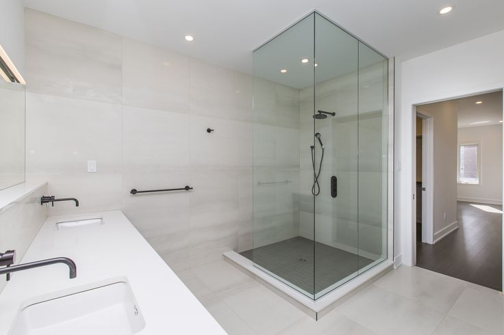 Stunning, spacious bathroom with walk-in shower and double-vanity sink, seen here in our 377 Dominion Avenue, Ottawa, property.