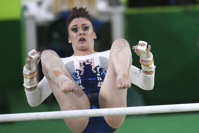 Ruby Harold of Great Britain competes on uneven bars during the women's team…