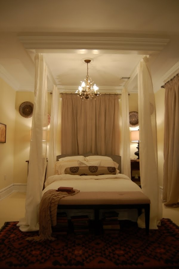 Love using the crown molding above the bed on the ceiling, to define the bed - bedroom by Genevieve Gorder