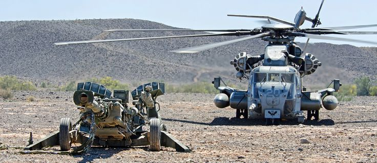 CH-53E Super Stallion Behind a M777 Howitzer | Military