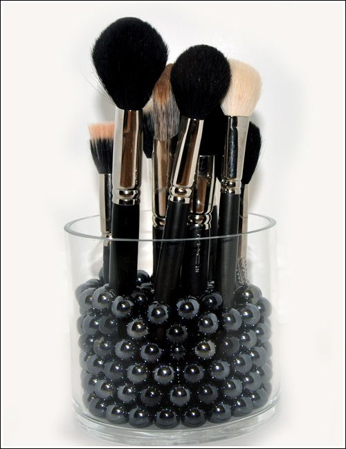 Makeup brush holder. Ive been looking for a way to hold my brushes without them touching. Such a great idea!