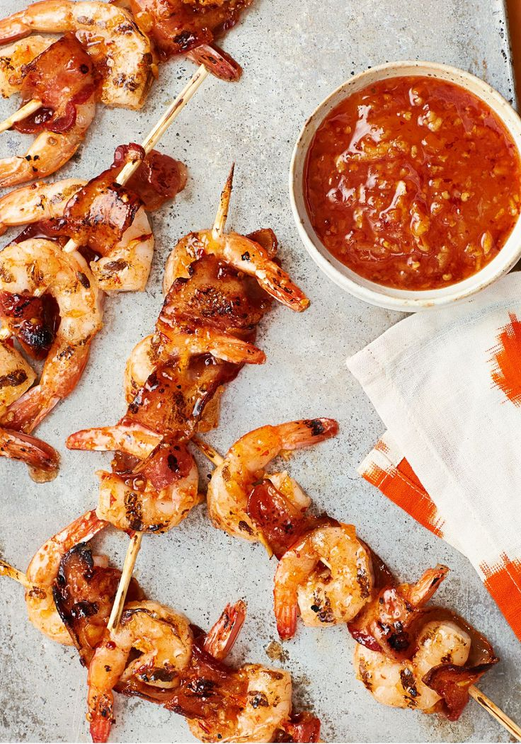 Bacon-Wrapped Shrimp Kabobs with Orange-Chipotle Sauce – In this classic kabob recipe, bacon and shrimp are skewered and dressed for the grill in an orange-chipotle sauce.