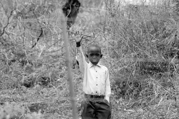 Child in The Meru - An African child standing along side a fence in the Meru National Park, Kenya  Taken February 2017