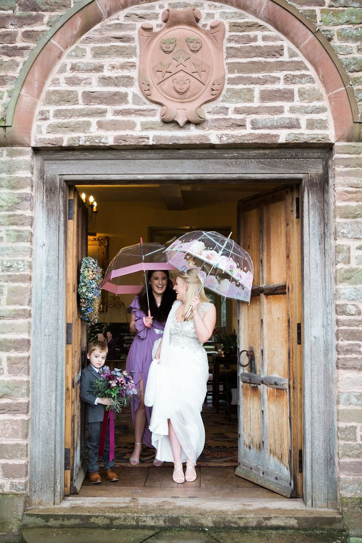 The bride wears Anna Campbell for her rainy day wedding at Dewsall Court. Photography by http://www.melissabeattie.com/.