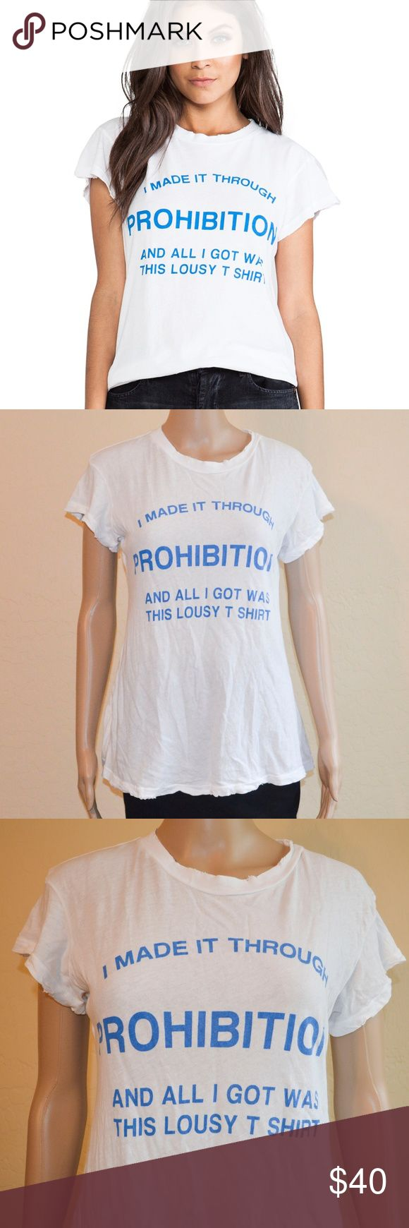 "Wildfox Prohibition White Desert Crew Neck T-Shirt Wildfox Prohibition tee. Blue block lettering on this soft white tee reads, ""I made it through prohibition and all I got was this lousy t shirt"". Intentionally 'worn' look around the edges. EUC - like new. Rare & hard to find. The only one listed on Posh and there are none on e bay.    Size: S  Measurements Laying Flat -  Underarm to Underarm: 18"" Shoulder to Hem: 25 1/2""  Material: 100% Cotton Made in USA Wildfox Tops Tees - Short Sleeve"