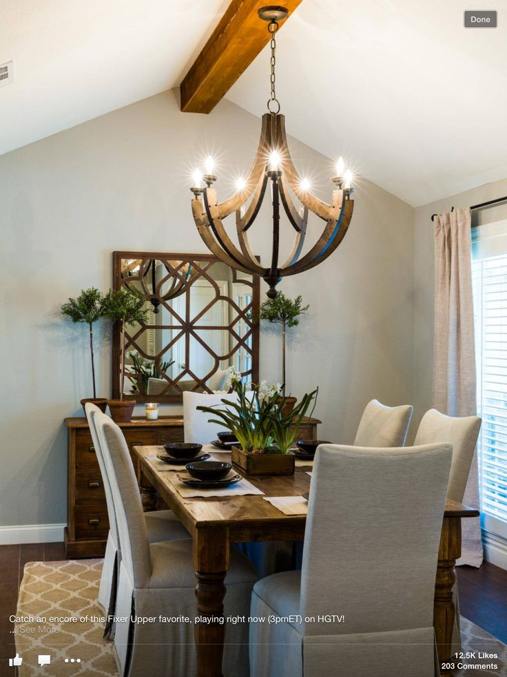 Formal Dining Room - MIrror over buffet. Green plants and vases.