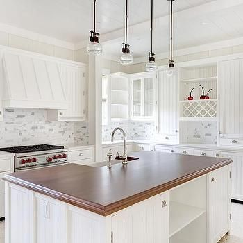 White Beadboard Kitchen Cabinets with Linear Marble Backsplash