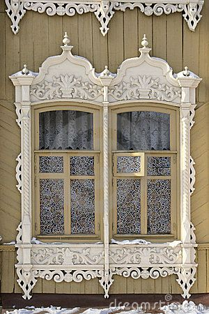 Old Russian windows in Tomsk by Alexey Kustov, via Dreamstime