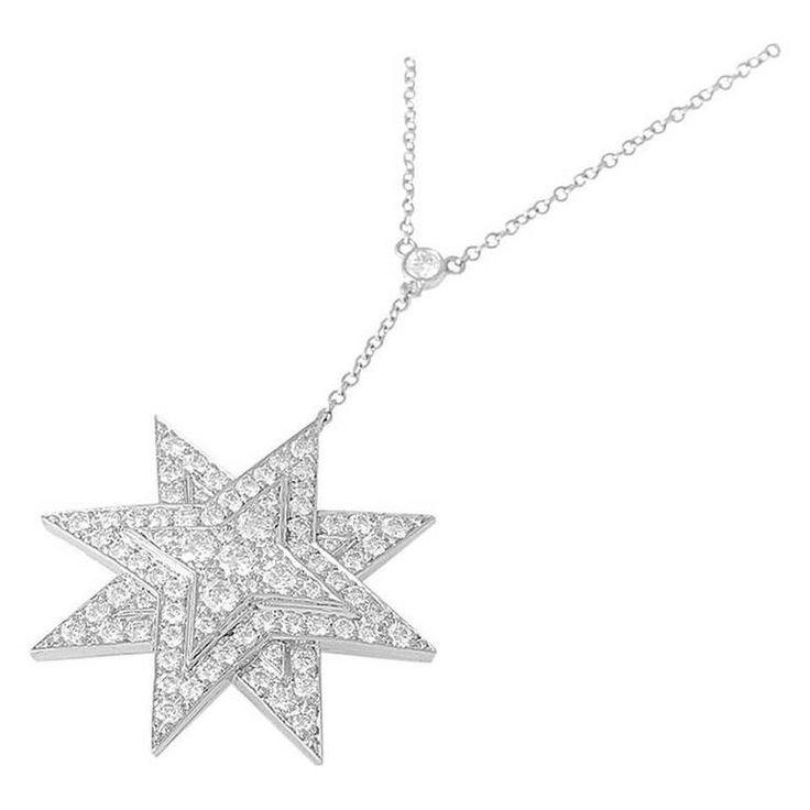 Tiffany & Co. Diamond Platinum Eight-Point Star Pendant Necklace -- The necklace boasts a diamond-accented chain with an eight-point star pendant also set with diamonds.