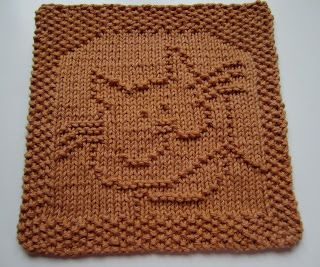 Free Dishcloth.  There's also a free pattern for a cat bib.  Down Cloverlaine: Mickey's Cat