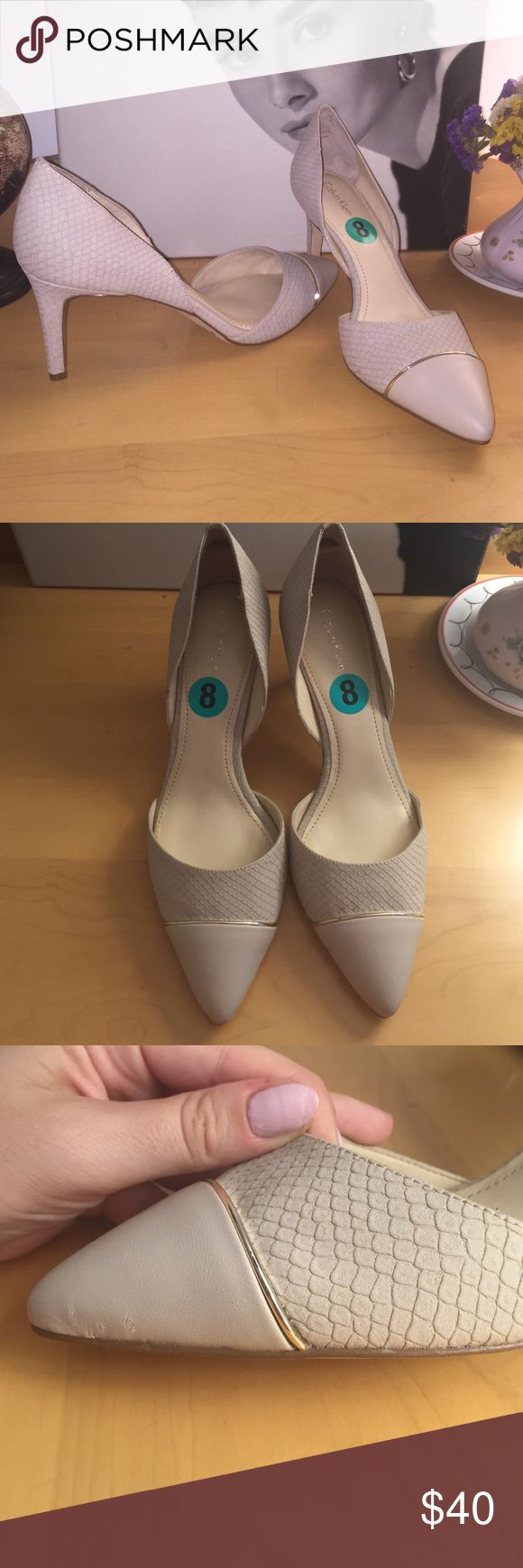 NWT CALVIN KLEIN Taupe Pumps * Details * size 8 Brand new never worn slip on Calvin Klein pumps. NWT from TJ Maxx $50! (Orig. $80) Color is elegant & diverse meaning it's an off white/taupe/light grey color depending on the lighting. Scallop style detailing all over & pretty dainty gold strap and solid pointy tips. Very very minor imperfections on tip of front (see close up) never noticed when I purchased & you can't see while wearing, just sharing for transparency. No-slip elastic band in…