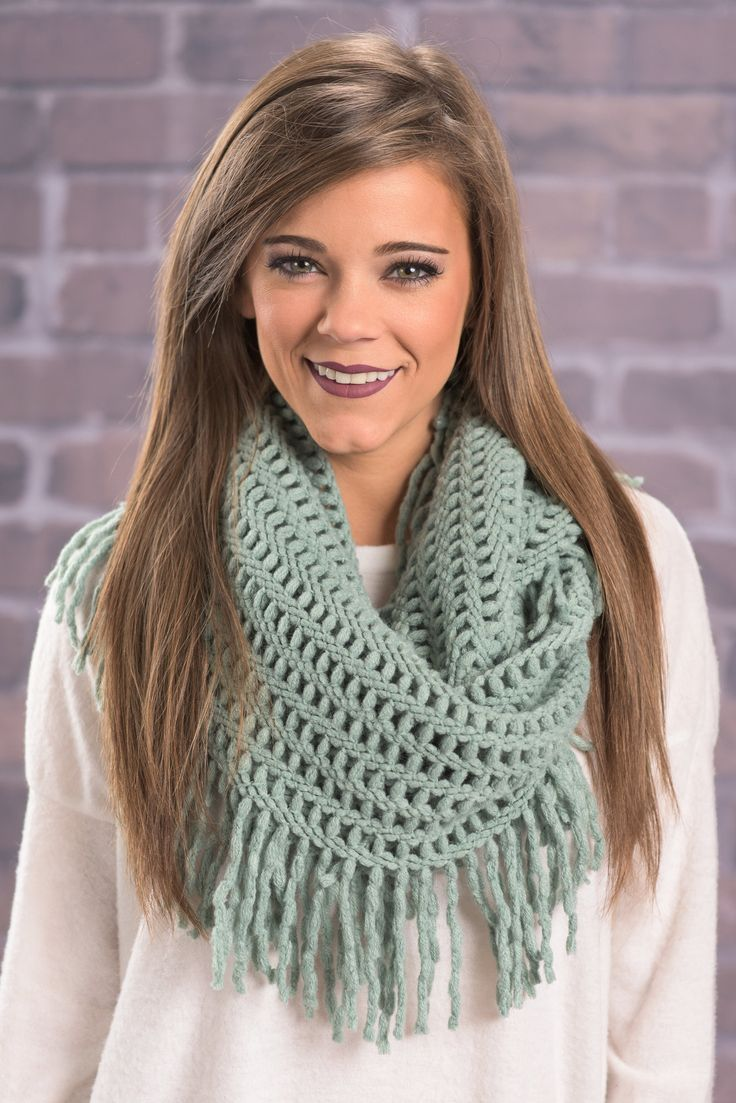 This warm and cozy scarf is so pretty! We are in love with that color! The fringe is also really fun! It gives this scarf a lot of movement!