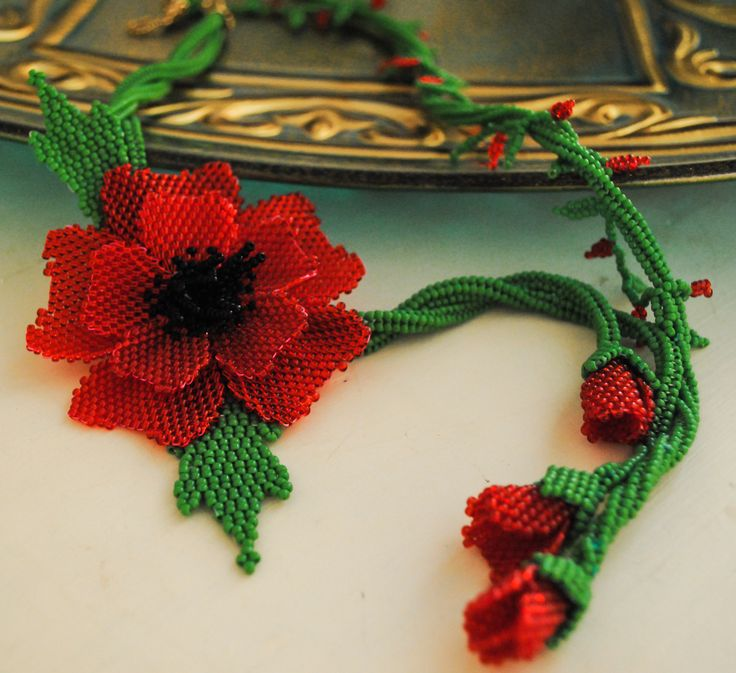 poppy flower glass bead necklace. red and green color. makes an awesome gift. $195.00