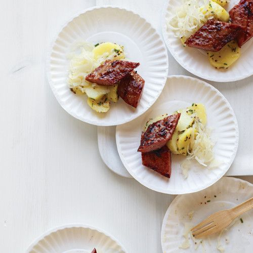 Links of Polish sausage are grilled to highlight their garlicky flavor. Sliced into small pieces, they contrast nicely with buttery Yukon gold potatoes with a light coating of grainy-mustard vinaigrette.
