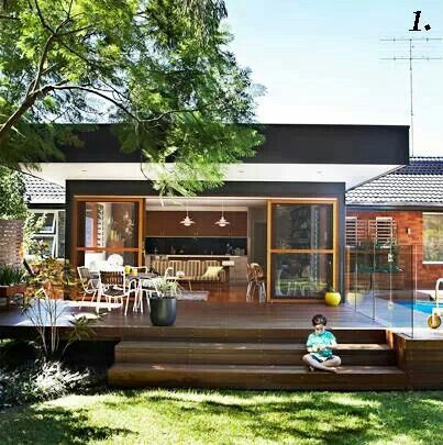Think about how your deck connects with your garden - great stair treads here to sit on. Home beautiful magazine Australia.