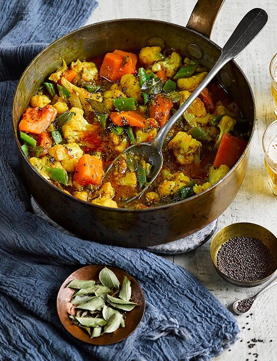 Sri Lankan curries are heavily spiced, chilli-hot and rich with coconut milk. This version is easy, vegan and under 500 calories