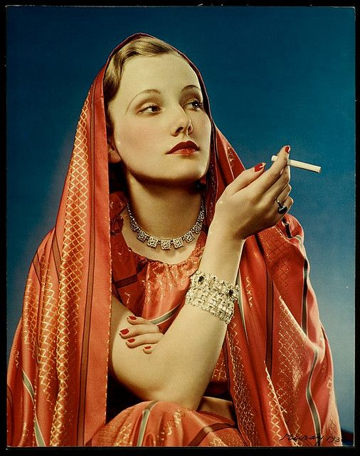 Vintage advert for Lucky Strike cigarettes from 1936 titled 'Lucky Strike: Girl in Red'. The model looks so exotic in the photo and I love the white tips to her manicure!
