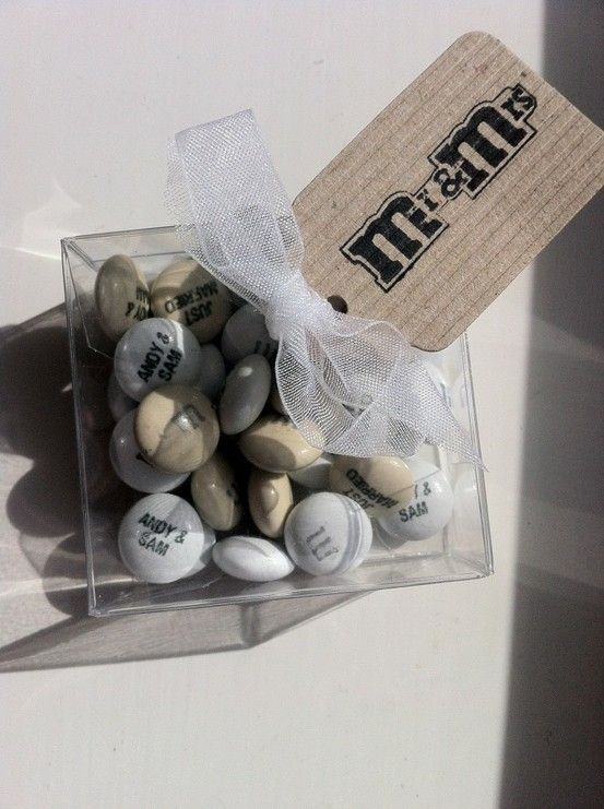 Personalized Ms in your wedding colors as wedding favors. Very cute. =) http://weddite.com/