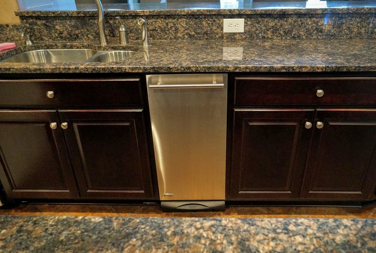 Custom Dark Stained Kitchen Cabinets, Stainless Appliances, Pull out Trashcan, Stainless Hardware, Custom Countertop