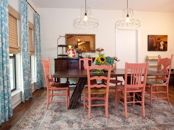 Mismatched chairs in the same shade of pink are placed for Property brothers dining room designs