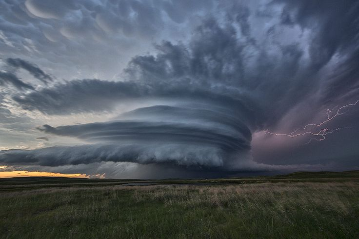 Stunning supercell thunderstorm over the sandhills of Nebraska on June 12th. This storm produced numerous tornadoes, but the structure was the best part. Absolutely gorgeous scene! This was taken on our storm chasing tours at www.silverliningtours.com .